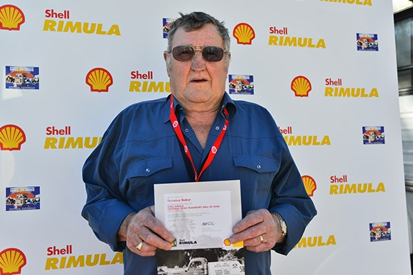 Former Kwikasair driver Terry Baker, a veteran of 48 years on the road, with his induction medal and certificate. Photo courtesy Viva Energy.