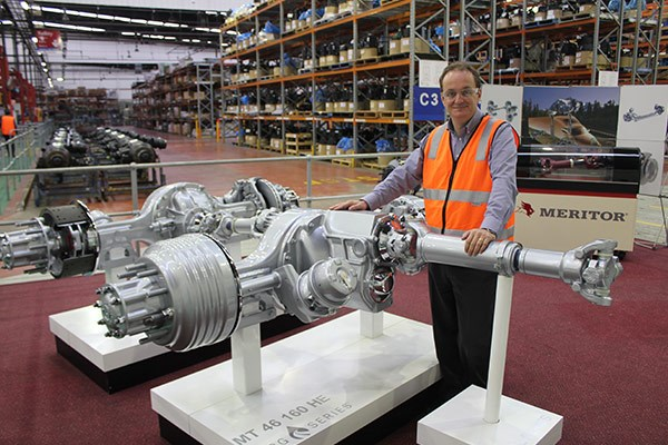 Final product: Meritor's Michael Snell stands with a show version of the well-known Meritor 46 160 drive axle set.