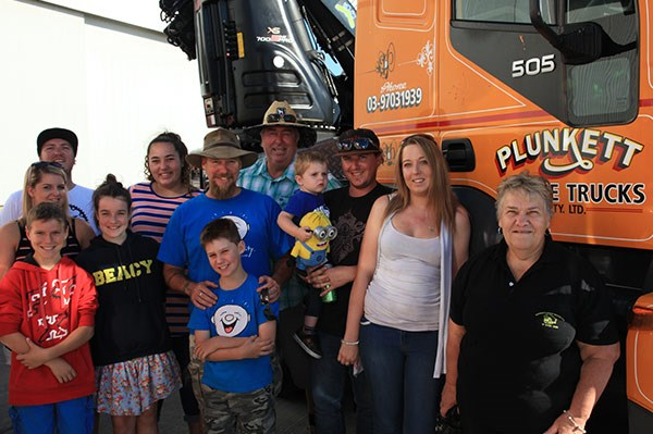 Ashley Davidson and son Jay, centre in blue shirt, with the Plunkett Crane Trucks team.