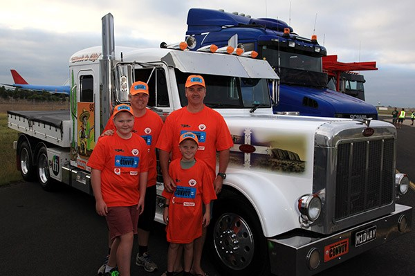 Left to right, (rear) Jack Rotnick and Damien Bennett with (front) Lindsay Rotnik and Rueben Bennett, and the mini Peterbilt.