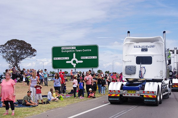 Spectators lined the streets as the convoy arrived at Gungahlin.