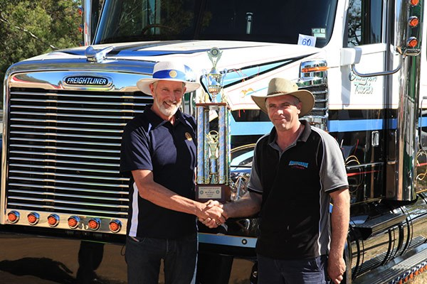 Castlemaine Rotary's Rob Cordy congratulates Michael Bransgrove, Saturday's 'Rig of the Day' winner.