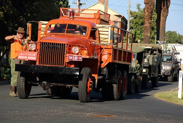 Owner-driver John 'Dutchy' Oldenmenger marshalling a Studebaker fire truck prior to the Corowa parade.