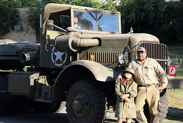 Ron Fry and his daughter Matilda Fry with Ron's Mack tank transporter which carries a tank.