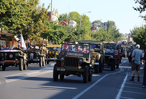 Jeeps lead a parade of 200 military trucks down Sanger Street, Corowa.