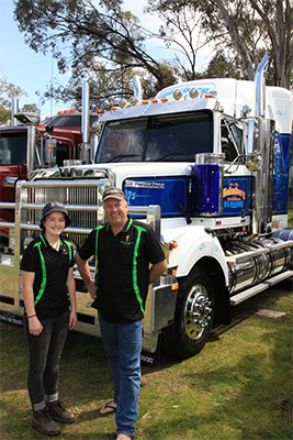 Cole Holmberg and his daughter Clara with Cole's 2013 Western Star.