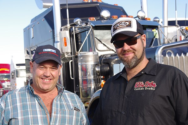 Nathan Gordon and Justin Klos up front of Dave Larsen's refurbished W model Kenworth.