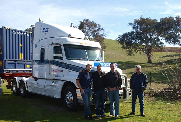 From left, Richard Cant, John Cant, Ken Reardon and Trevor Ellwood with an Allalong Freightliner. Photo by John Cant.