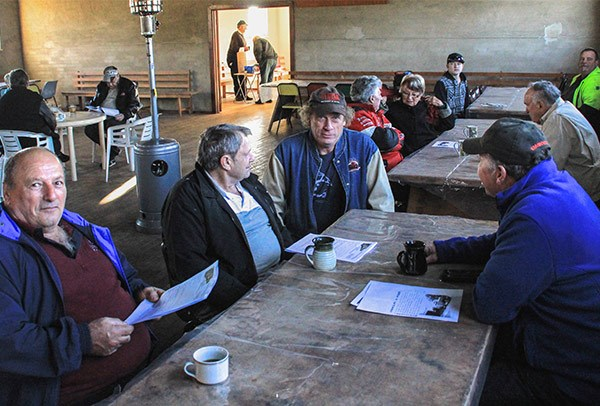 From left, Tony Muscat of Yass, John Scott of Wodonga, Paul Flanagan of Wagga Wagga and Jimmy Townsend of Yass enjoy breakfast at Tumblong before the road run.