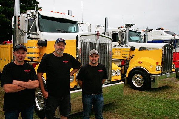 From left: John Maher, Steve Russell and Greg Searle brought two of Modern Towing's tow trucks along for the day.
