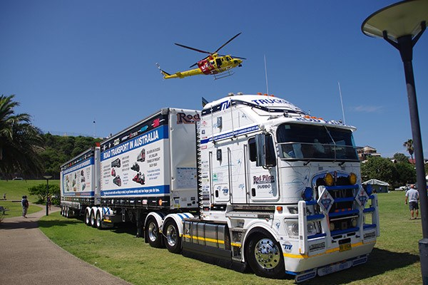 The Westpac Rescue Helicopter buzzes the Truck Right Industry Vehicle at Foreshore Park.