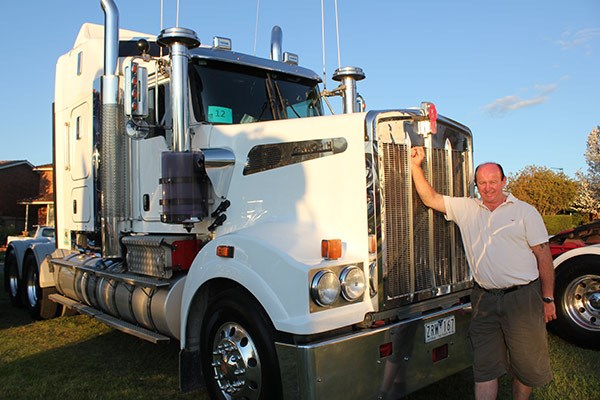Peter Ovens with one of the many big bonneted Kenworths at the show.