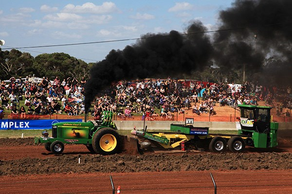 The tractor pull event brought spectators in from the big smoke.