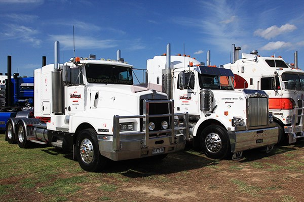 Two of Rod McIntosh's trucks — the Kenworth T600 was runner-up in the Best Prime Mover 17 to 25 years section.