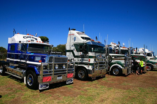 Cora-Lynn Transport's flashy Ford alongside the Membrey's fleet.