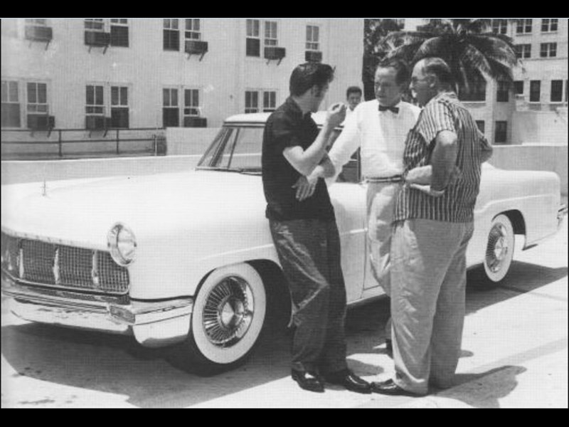 Elvis Presley and his 1956 Lincoln Continental Mark II