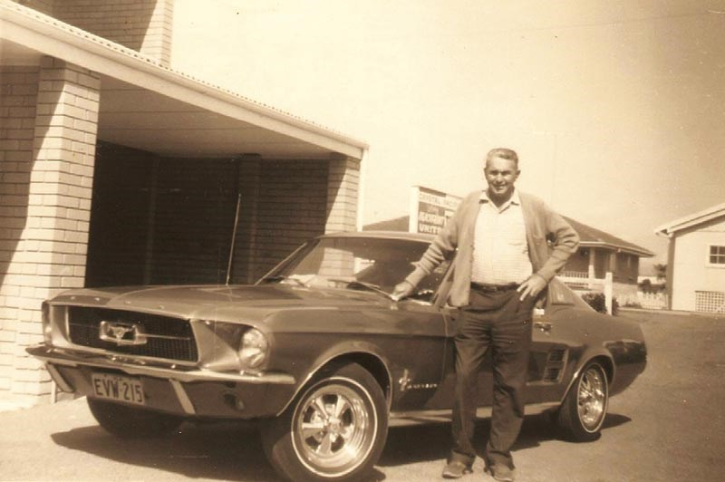 Glen's grandfather with his mustang coupe, brand new in 1967