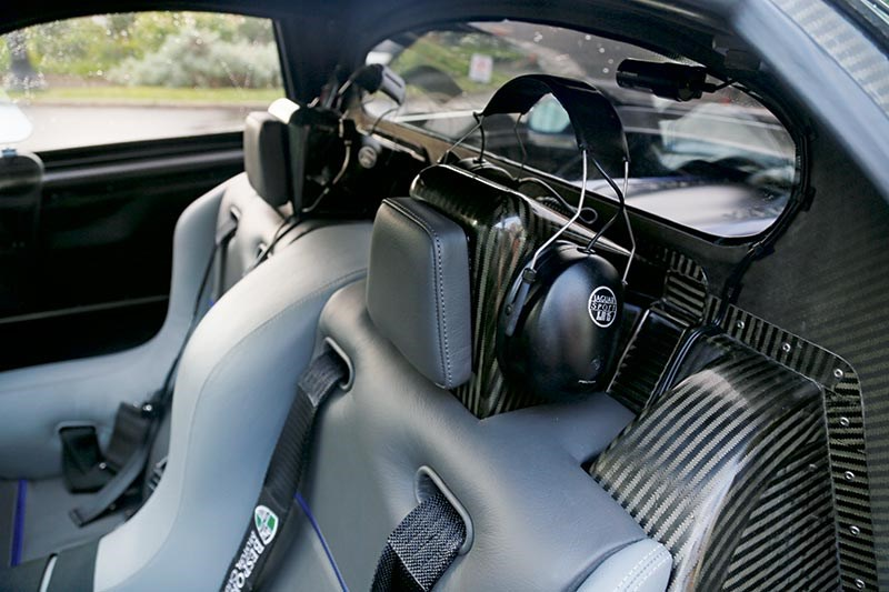 Only millimetres of carbon separate your temporal lobes from TWR/Jaguar Sport's V12. Headsets are not ornamental