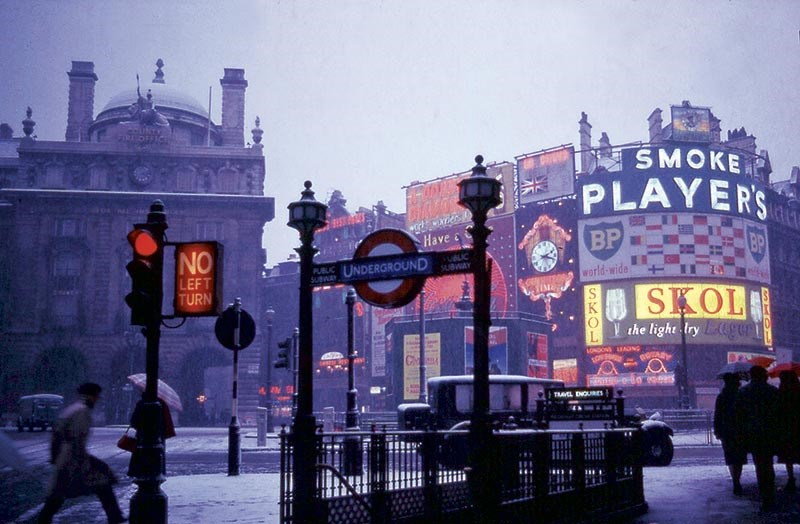 Cruising below the neons at a snowy Piccadilly Circus, London