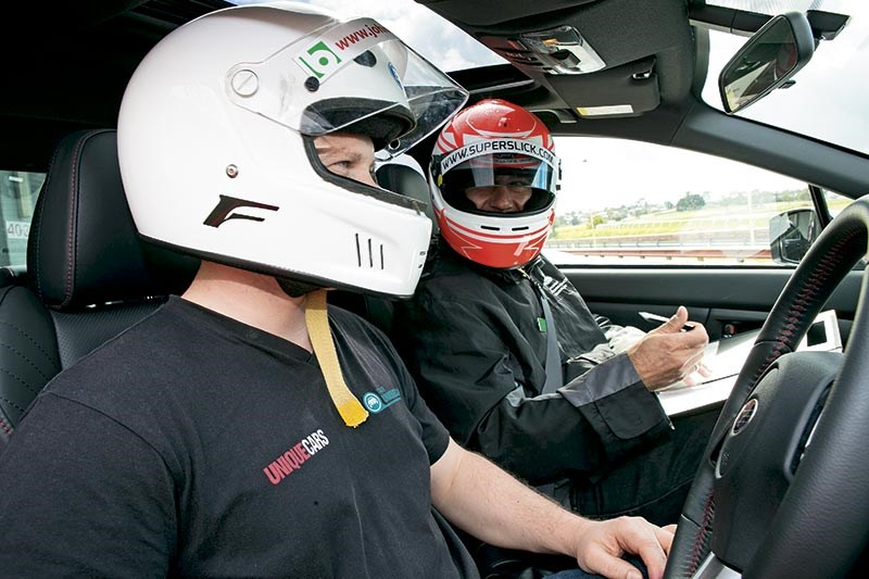 Instructor Iccy assesses and takes Scott through the finer points of the lap