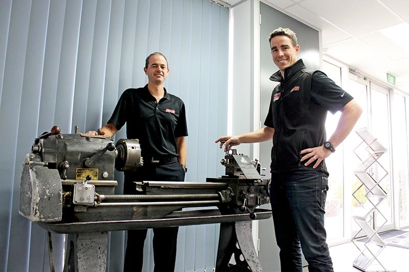 Tim Harrop and Heath Moore show off one of the company's original lathes