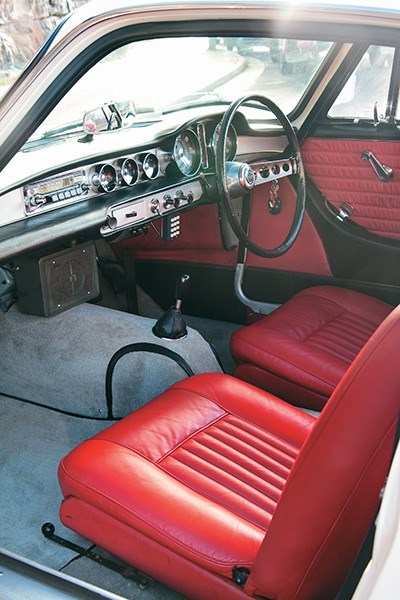 The red leather interior is in as-new condition