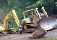 Video: Slippery slope for Cat and Kobelco