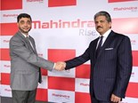 Mr Anand Mahindra, Mahindra Gorup chairman and Mr S.P Shukla, President-Group Strategy and Chief Brand Officer of Mahindra Group unveiling the business' new visual identity which has been reflected across all its global businesses from January 2013