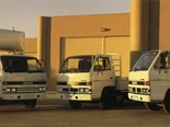 Three 1989 Isuzu NPR Trucks