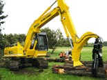 The brand-new Sumitomo SH240-5 excavator about to engage in some serious forestry work.