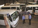 Evan and Scott Isaacs check minibuses for refurbishment