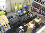Teams compete in a bus chassis task at the event