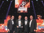 MAN Truck & Bus UK managing director Thomas Hemmerich, second from left, receives the award