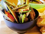 Green-lipped mussels with kaffir lime, cider and spring onions