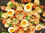 New potato salad with streaky bacon and soft eggs