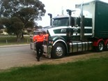 Joshua when he was a bit younger, standing proudly beside the Mack his uncle drives for Stawell Freighters.