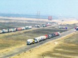 Holiday snap: Trucks lined up to cross the Suez Canal. Not many bonnets and no obvious toilet facilities