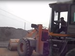 Small child operating wheel loader