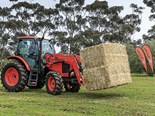 The Kubota M100GX tractor in action.
