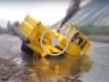Video: Russian tractor stuck in a river
