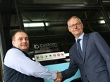 Scott Dunn, managing director and owner of Custom Bus Group, officially hands over the 100th bus to Steffen Faurby, CEO of State Transit.