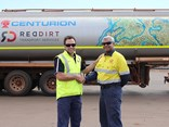 Fortescue community development manager Heath Nelson with Red Dirt Transport Services director Steven Dhu, in front of its new fuel tanker with artwork commissioned from Yindjibarndi artist Allery Sandy