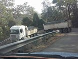 The driver of a tipper and dog combination was fined and issued six infringement points.