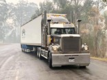 A Bobbins Western Star semi wreathed in smoke