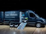 A Mercedes-Benz Sprinter van acts as the prototype mobile loading and transport hub for eight of the delivery robots.