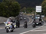 A police escort guides the convoy, led by Yatcon Civil's Kyecon Kenworth, towards Shellharbour Airport during the i98FM Illawarra Convoy.