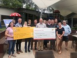 The Newcastle Hunter Region Transport Awareness Day committee hands over the cheques to beneficiaries Westpac Rescue Helicopter and Ronald McDonald House Charities on February 5