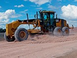 The Caterpillar 140M Grader in work mode on a cattle feed lot near Goondiwindi QLD
