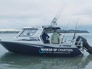 On-board a fishing charter in Auckland
