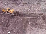 Cat D11 dozer on hair raising slope